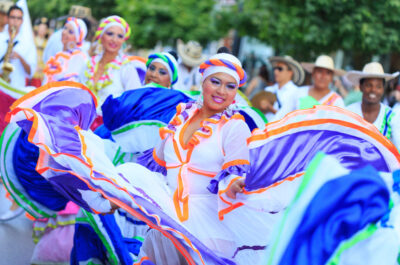 Veliko Tarnovo, Bulgaria - July 25, 2015: Colombian folklore group dancing in Veliko Tarnovo. Colombian girls in traditional costume plays traditional dance on
